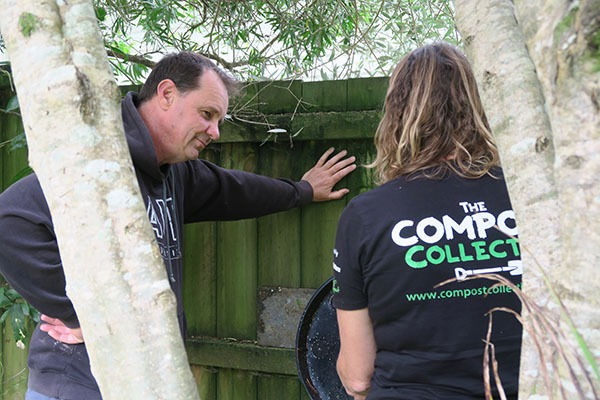 Andrew discusses his worm farm with a Compost Collective facilitator